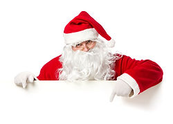 Santa Claus pointing in blank advertisem