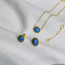 """Sterling Silver set of Earrings nad Necklace with Synthetic Turqouise. Length 16"""". In Yellow Gold Plate"""