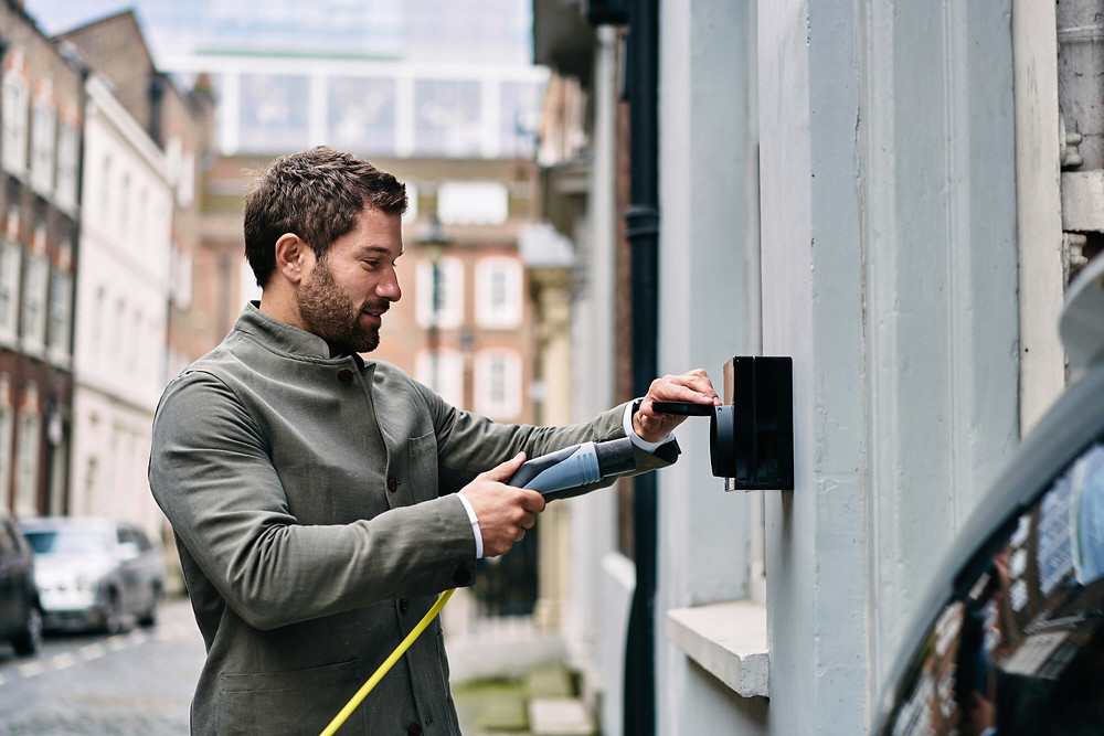 Man plugging in charger