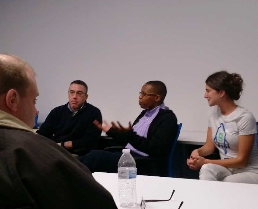 LaShana Lewis sitting down and explaining diversity in the workplace during a LaunchCode event October 2015.