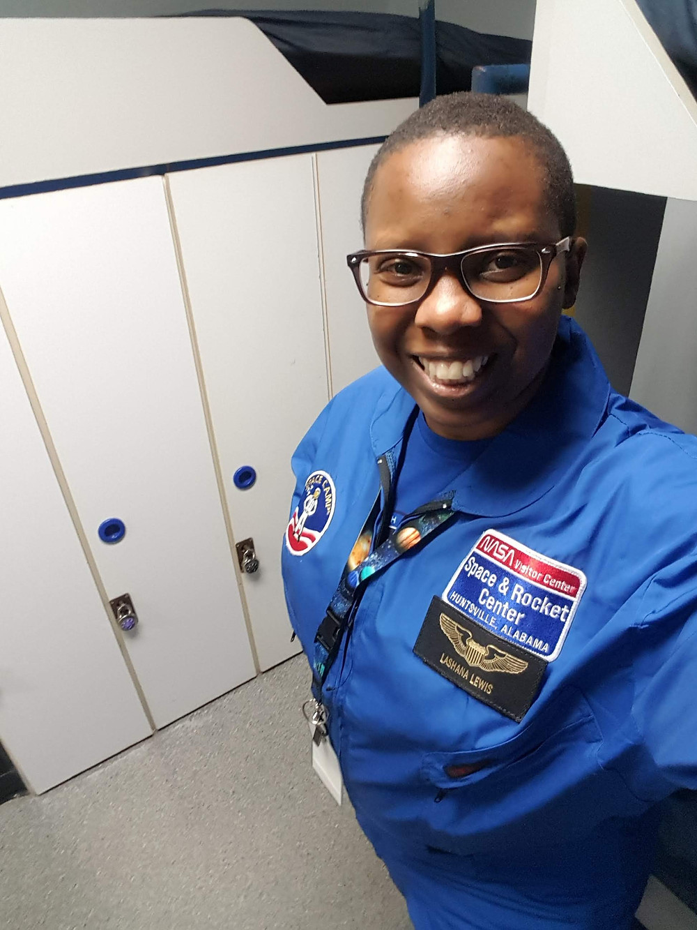 LaShana Lewis pictured in Space Camp royal blue flight suit during Space Camp for Adults in the Summer of 2018
