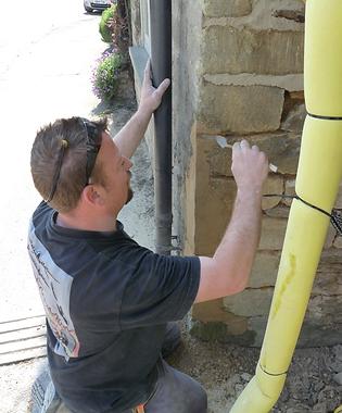 Toby Robson repairing stone work