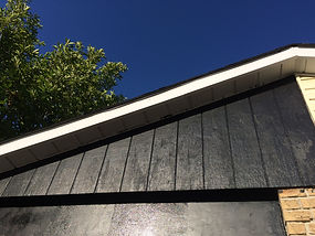 Weathered and Aged Fascia Above Garage T