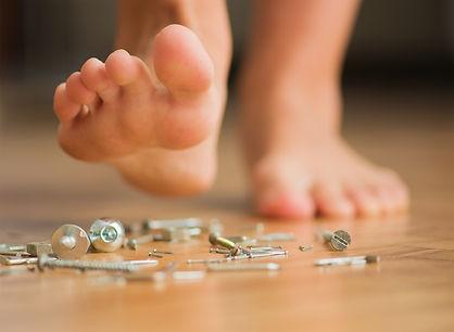 bigstock-Human-Foot-Over-Nail-Indoors-43