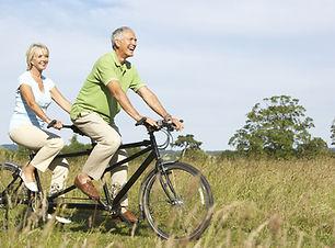 bigstock-Mature-couple-riding-tandem-139
