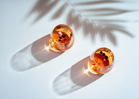 Two drinks (aperol) with light and shadow reflection