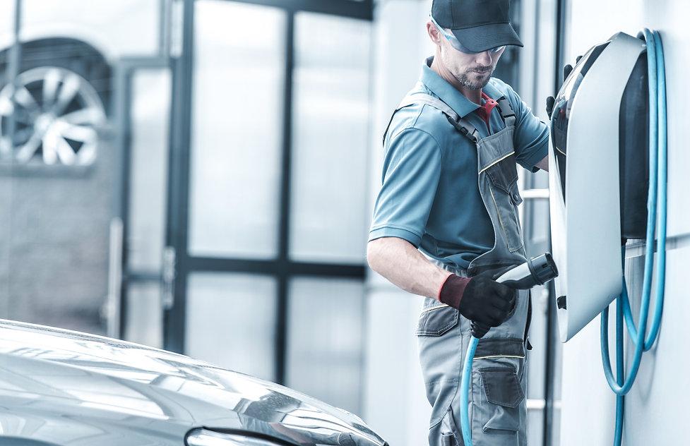 Caucasian Automotive Technician Testing