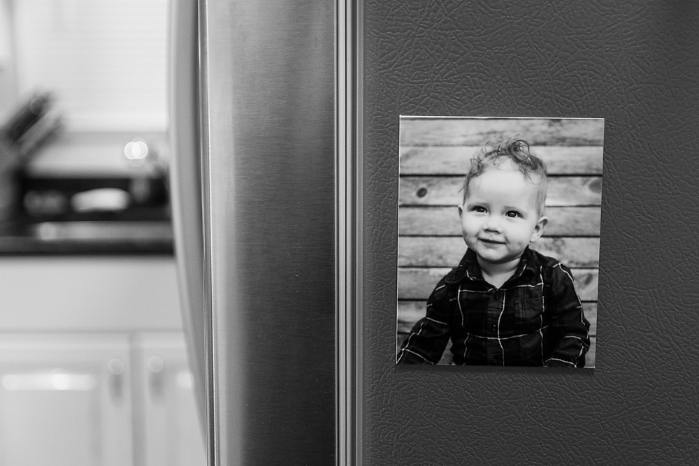 photo magnet on refrigerator