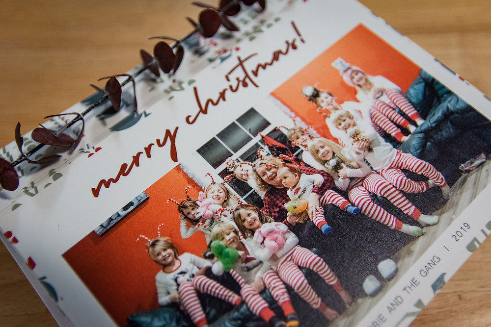gift idea christmas card grandkids holding stuffed animals in matching striped christmas pajamas and candy cane headbands