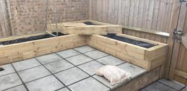 Garden paving and raised sleeper flowerbeds built