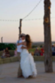 Couple dancing under the stars on the lighted outdoor dance floor.