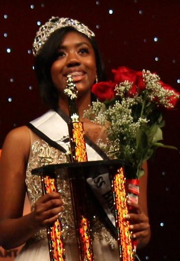 Crowned with sash trophy roses.jpg