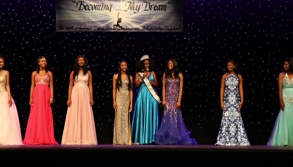 Group on stage evening gown.jpg