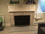 Fireplace brick painted and than glazed with another color. Mantle painted.