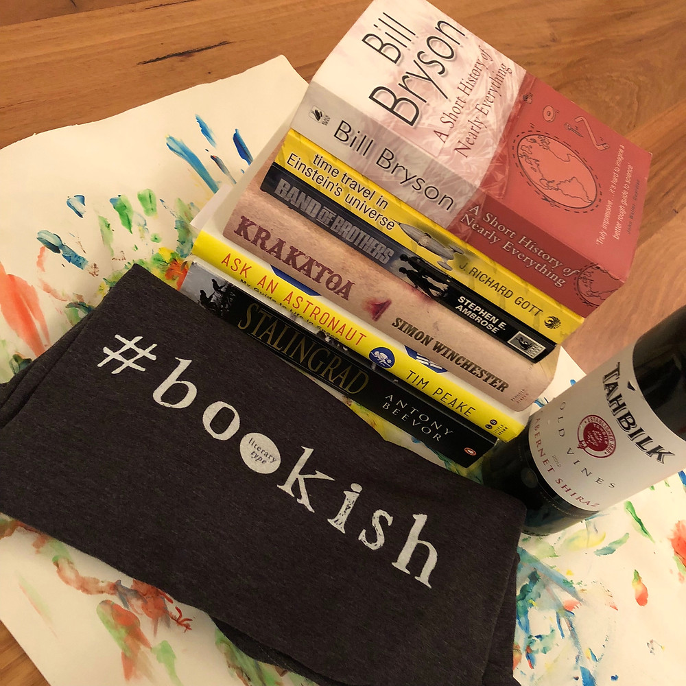 Bookstack, tshirt and wine