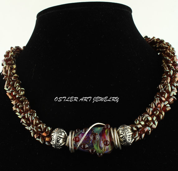 Handmade, flameworked glass bead with magatama seed bead necklace