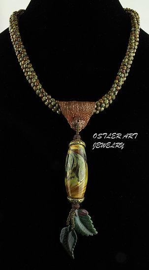 Handmade, flameworked glass bead on a Czech glass kumihimo necklace