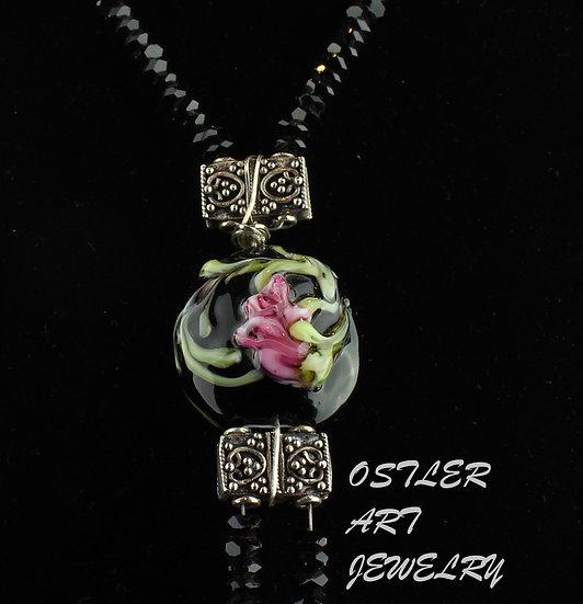 Handmade, Art Nouveau style bead on a black crystal necklace
