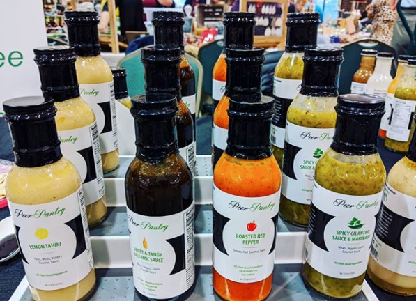 A collection of sauces of various flavors and colors from Peer Pantry in Cleveland