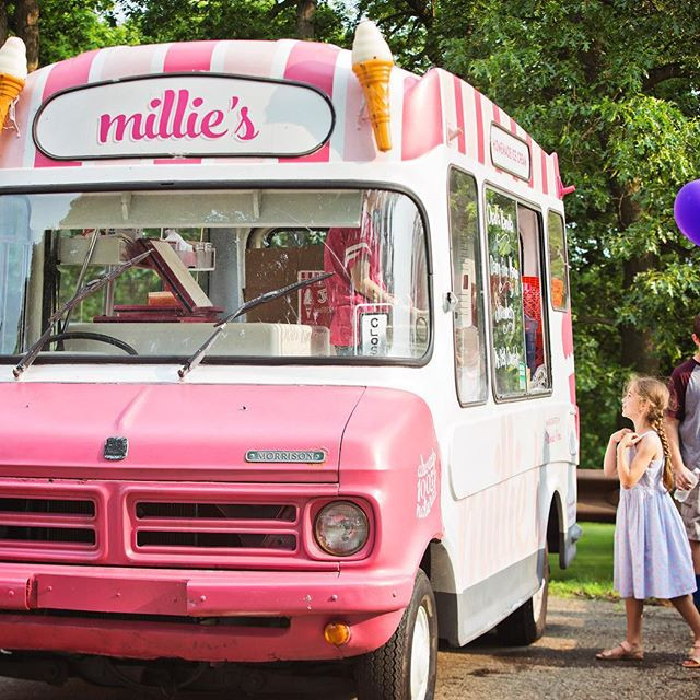 A small girl steps up to the new Millie's Homemade Ice Cream truck