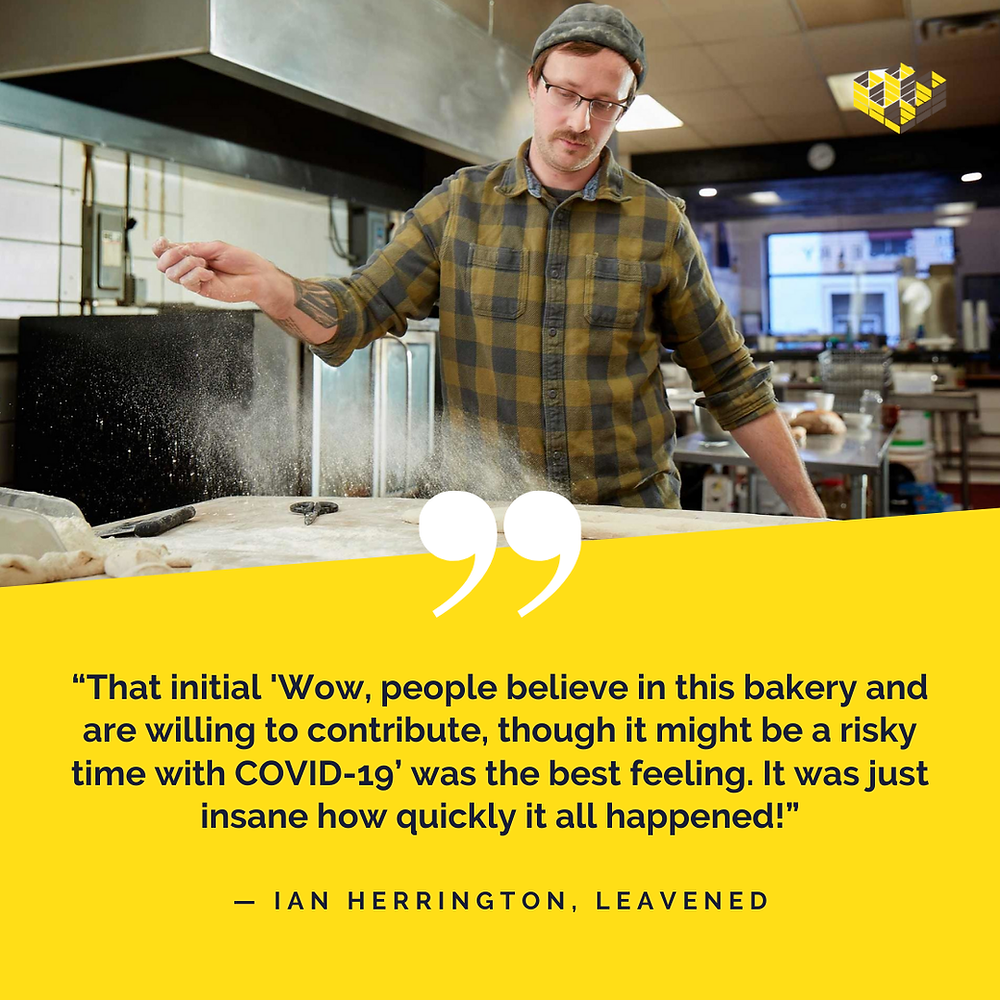 Owner Ian of Leavened bakery throws flour onto dough in the kitchen
