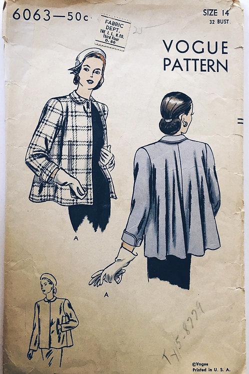 Vogue 6063. 1947 Short, flared-back coat.