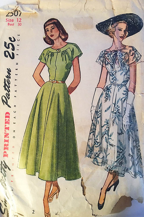 Simplicity 2507. Vintage 1940s dress with overlay and bias full skirt