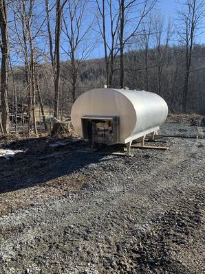 Old milk tank used for sap storage