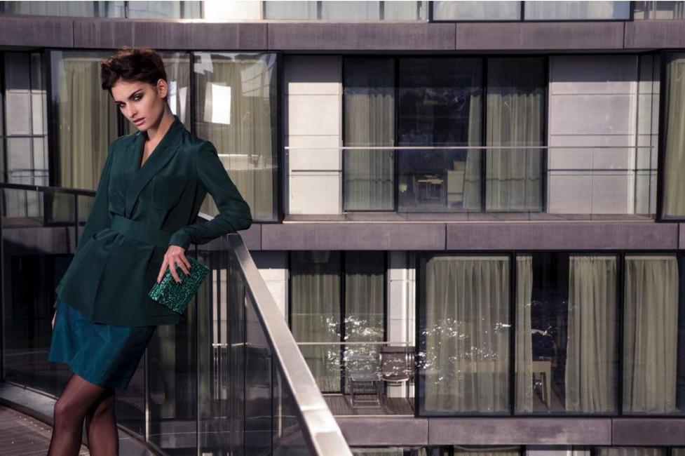 model-green-skirt-blouse-glass-wall-layr