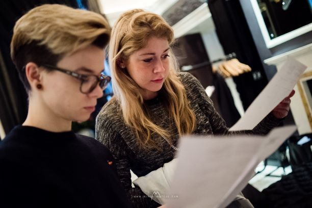 Photo shoot coordinator and assistant are reviewing fashion styles on a production day, The Wellesley Hotel, London,