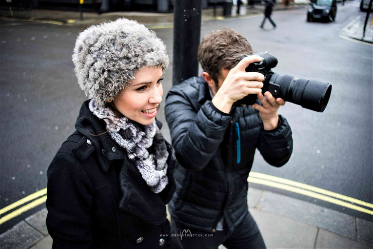 Art director and fashion stylist Layra Harmony with a photographer behind the scenes of a photo shoot in central London, UK