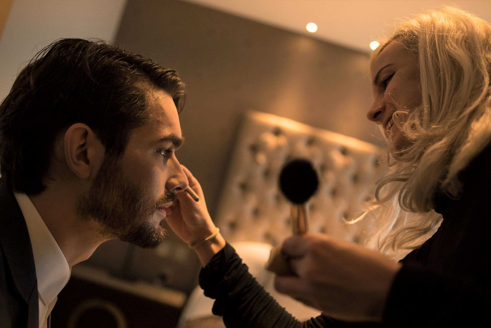 Make up artist worjking with a male model on a photo shoot production, Monte Carlo, UK