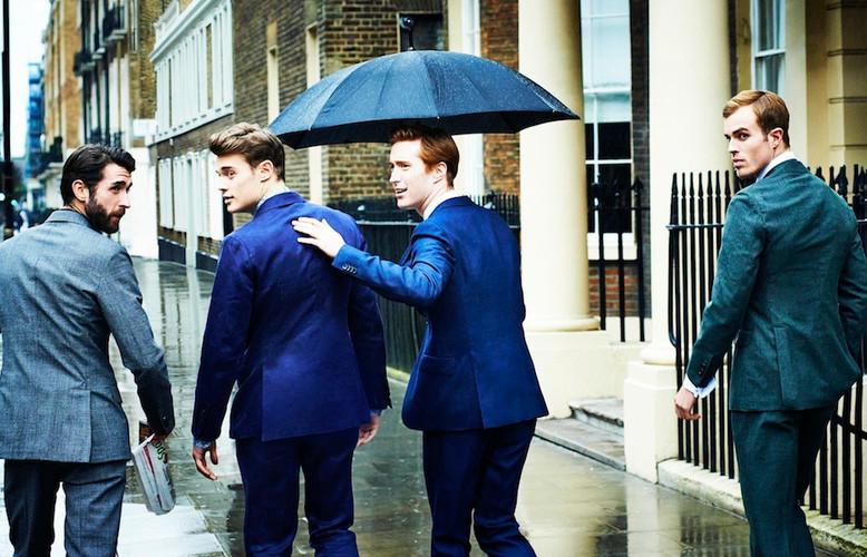 london-street-men-suit-walking-umbrella-