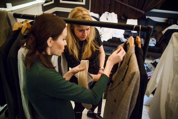 Renowned fashion stylist Layra ahrmony is looking through garments posted by high end brand for a  photo shoot production