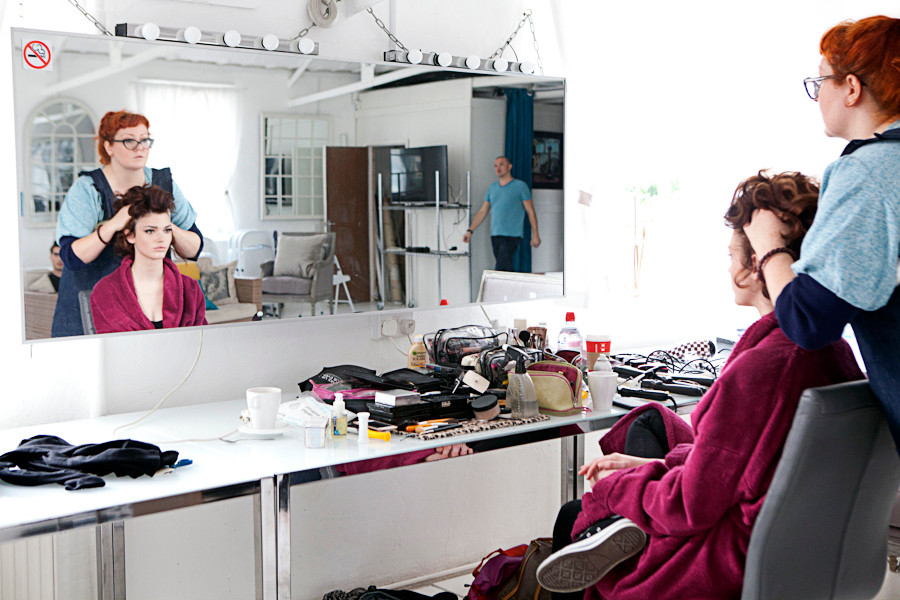 -make-up-hair-styling-female-model-behin