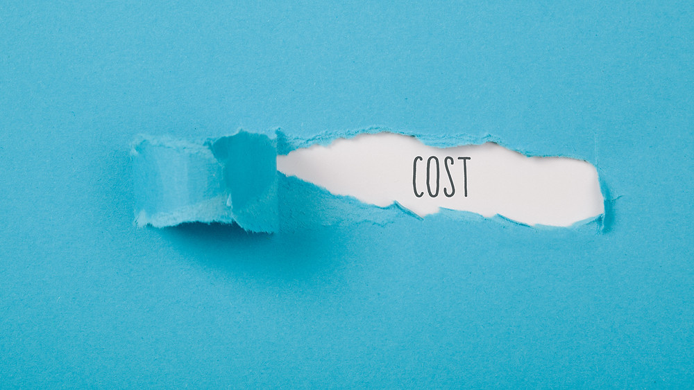 """Blue piece of paper hiding the word """"cost"""" underneath."""