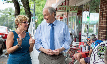 Sam talks to a small business owner in the 113th district