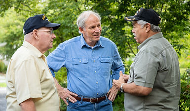 Sam Edney talks with veterans in the district.