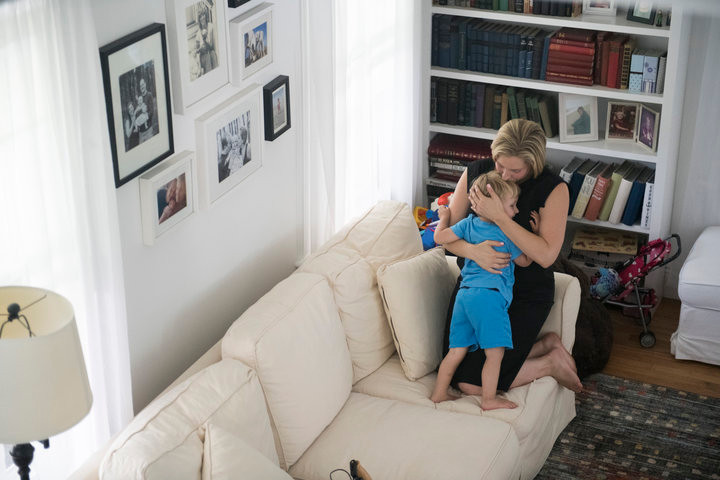 Congressional candidate Liuba Grechen Shirley, the first federal candidate to get permission to spend campaign funds on child care, takes a break from shooting her campaign ad to hug her son.