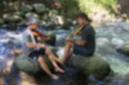 Milo in creek.JPG