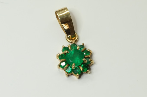 18k ygold pendant 035ct emerald flower pendant colaus natural special emerald flower pendant set in 18k yellow gold with 11 natural colombian emeralds hexagon cut the centre stone 035cts approx with 10 small x point aloadofball Image collections