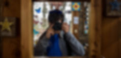Jared Mayerson using a camera