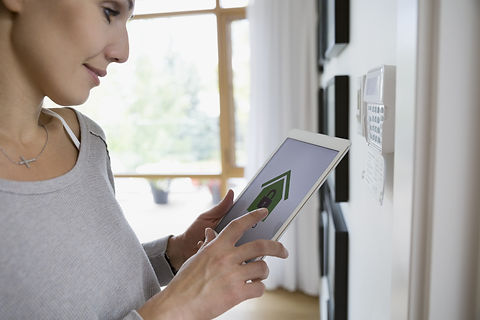 woman using smart heating controls