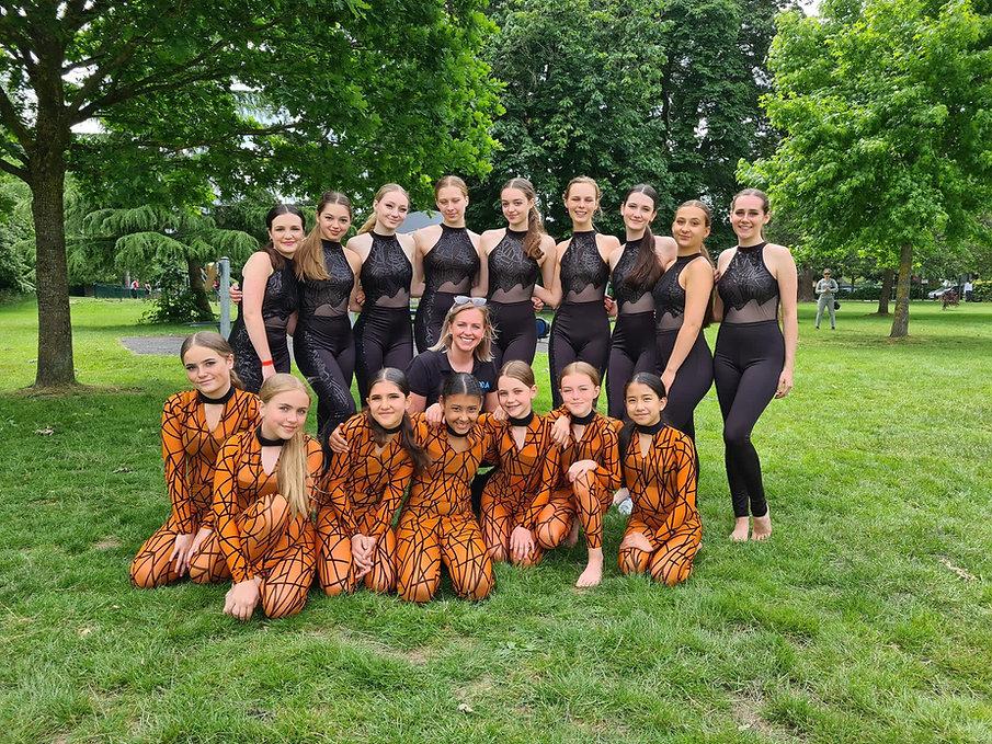 dancers in costume standing outside.jpg