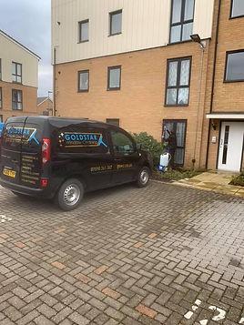 Goldstar van outside flats.jpg