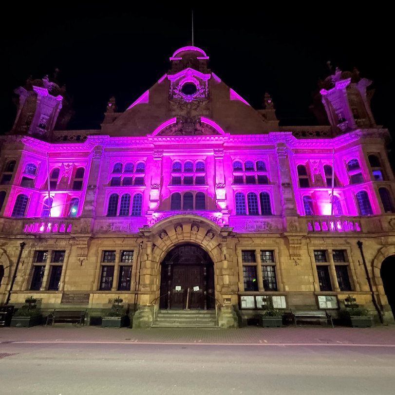 building lit with pink glow.jpg