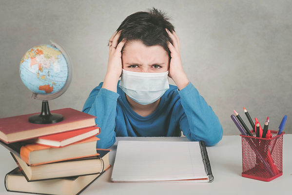 angry child wearing medical mask fed up
