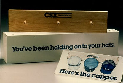 """Fourth of 4 boxed mailings -- """"Here's The Capper!"""" — emabl d receipient to hand3 hats already received on this hat rack."""