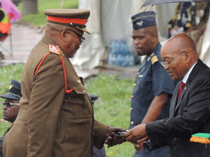 Zuma lays wreath, presents medals during wet Armed Forces Day