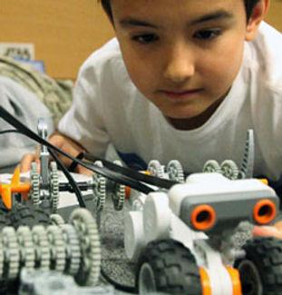 kid working on robotics project